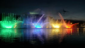 Colorful bright fountain with beautiful reflection stock footage