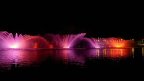 Colorful bright fountain with beautiful reflection. Amazing fantastic colorful fountain with bright illumination on the water pond or river with beautiful stock video