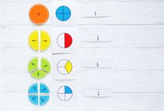 Colorful bright fractions in mathematics on white wooden table. interesting math for kids children. Education, back to school stock photo