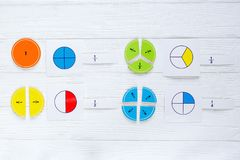 Colorful bright fractions in mathematics on white wooden table. interesting math for kids children. Education, back to school royalty free stock photos