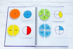 Colorful bright fractions in mathematics on white wooden table. interesting math for kids children. Education, back to school royalty free stock photography