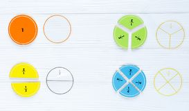 Colorful bright fractions in mathematics on white wooden table. interesting math for kids children. Education, back to school stock images
