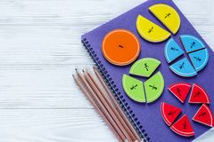 Colorful bright fractions in mathematics on white wooden table. interesting math for kids children. Education, back to school stock photography