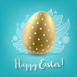 Colorful bright golden Easter egg on green blue background. Stock Photos