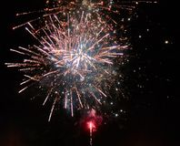 Colorful bright golden and red fireworks and smoke in the night sky background royalty free stock photography