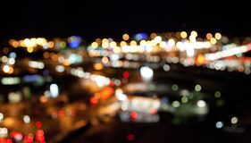 Colorful bright lights on dark night background Stock Photos