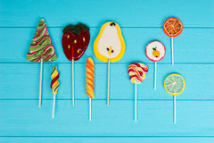 Colorful bright lollipops as fruits and Christmas Tree on turquo Royalty Free Stock Photo
