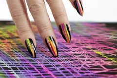 Colorful bright manicure with different sharp shape of nails framed with black lacquer.Nail art. stock photos