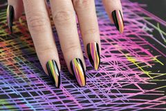 Colorful bright manicure with different sharp shape of nails framed with black lacquer.Nail art. stock photography