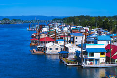 Colorful bright modern houseboats street on stilts Columbia Rive Stock Photos