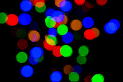 Colorful bright night lights over black background Stock Images