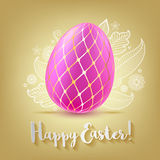 Colorful bright pink Easter egg on golden background. Stock Image