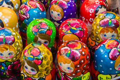 Colorful bright russian nesting dolls Matrioshka at the street market at Old Arbat street, iconic popular souvenir from Russia. Royalty Free Stock Photography
