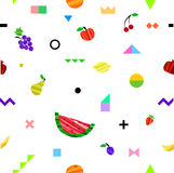Colorful bright seamless pattern with different fruits and geometric elements in tribal Memphis style. Stock Photos