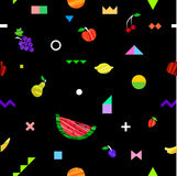 Colorful bright seamless pattern with different fruits and geometric elements in tribal Memphis style. Stock Photography