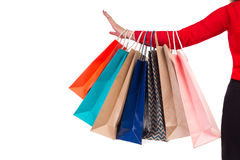 Colorful and bright shopping packages hanging on female red-slee Royalty Free Stock Photo