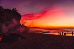 Colorful bright sunset or sunrise at tropical beach with ocean and waves. Colorful bright sunset or sunrise at tropical beach with ocean and wave royalty free stock images