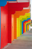 Colorful british beach huts Stock Images