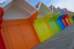 Colorful british beach huts Stock Photography