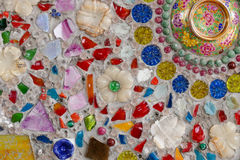 The colorful broken tile, bead, bowl and stone decorating on tem Stock Image