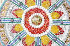 The colorful broken tile, bead, bowl and stone decorating on tem Royalty Free Stock Photo