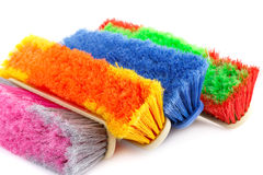 Colorful brooms Stock Photo