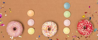Colorful brown carnival background with donuts and other funny items. Nice colorful brown carnival background with donuts and other funny carnival items royalty free stock photo