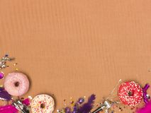 Colorful brown carnival background with donuts and other funny items. Nice colorful brown carnival background with donuts and other funny carnival items royalty free stock image