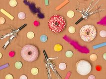 Colorful brown carnival background with donuts and other funny items. Nice colorful brown carnival background with donuts and other funny carnival items royalty free stock images