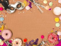Colorful brown carnival background with donuts and other funny items. Nice colorful brown carnival background with donuts and other funny carnival items stock photo