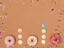 Colorful brown carnival background with donuts and other funny items. Nice colorful brown carnival background with donuts and other funny carnival items stock images