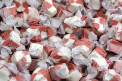 Colorful brown and white salt water taffy. Lots of colorful brown and white salt water taffy candies Stock Photo