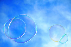 Colorful Bubbles. Against a cloudy blue sky in the summertime Stock Photo