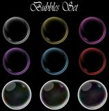 Colorful bubbles set on isolated black background. Royalty Free Stock Images