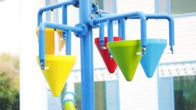 Colorful bucket splash in aqua park stock footage
