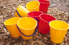 Colorful buckets. Colorfull plastic buckets on child's playground Stock Photo