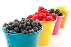 Colorful buckets fruit Royalty Free Stock Photos