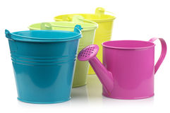 Colorful buckets and watering can Stock Image