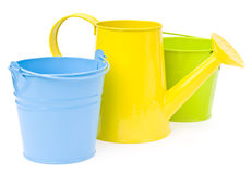 Colorful buckets and watering can Stock Photos