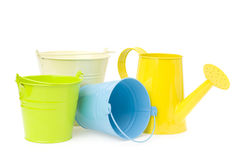 Colorful buckets and watering can Royalty Free Stock Photos