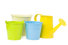 Colorful buckets and watering can Royalty Free Stock Image