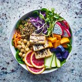 Colorful buddha bowl with grilled tofu and dragon fruit Royalty Free Stock Photo