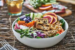 Colorful buddha bowl with grilled tofu and pea shoots Stock Photos