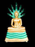Colorful buddha image. The Buddha statue style sitting meditation with serpent cobra hood spread behind his head covered. This is the Buddha for those born on Royalty Free Stock Photo