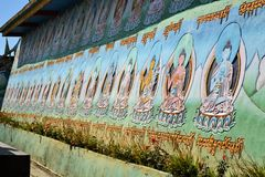 Colorful Buddhas on temple wall, Nepal Stock Images