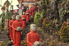 Colorful Buddhist monk statues, Hpa-An, Myanmar stock image