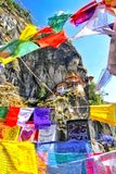 Colorful Buddhist prayer flags at Taktshang Goemba or Tiger`s ne