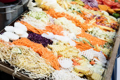 Colorful buffet of shredded and sliced vegetables. Such as carrots potatoes and red cabbage Stock Images