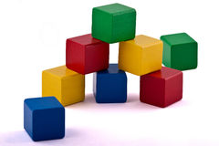 Colorful Building Blocks. Colorful wooden toy building blocks on white background royalty free stock photos