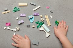 Colorful building blocks with baby hands stock photography